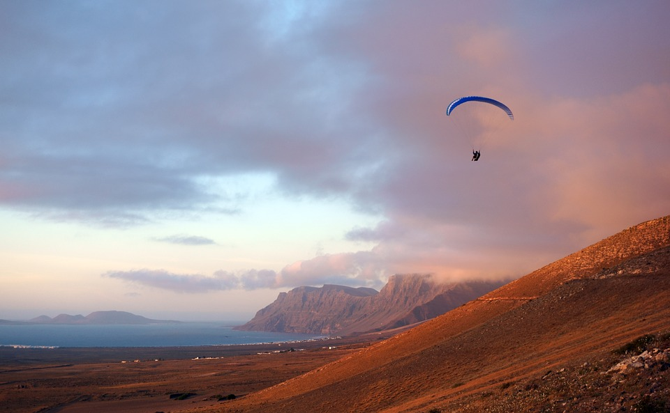 Canary Islands adventure holidays Guide to activities in the Canaries Paragliding in Famara, Lanzarote Pixabay royalty free image