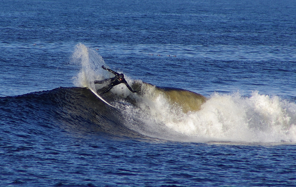 Surfing during Thurso adventure holidays in Scotland Flickr CC image by jack spellingbacon