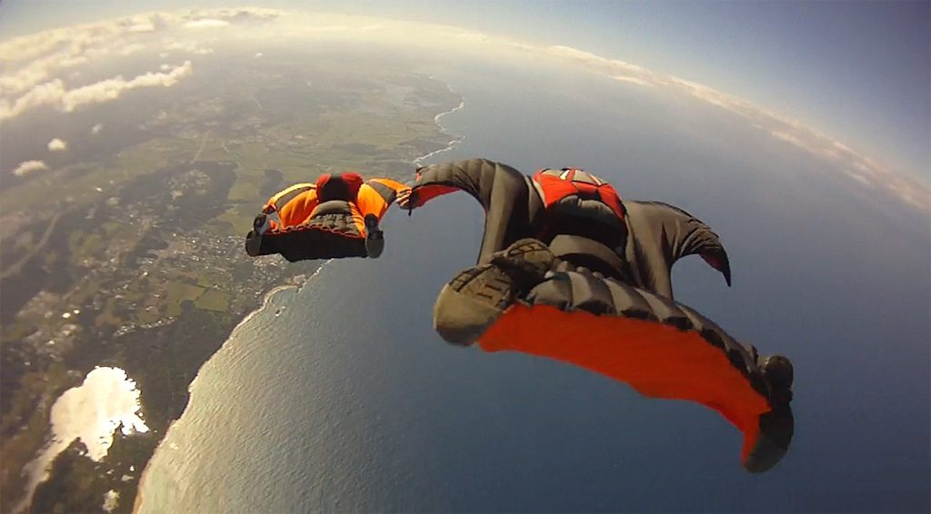 types of extreme Sport - wing suit flying - cc Wikimedia commons image - Ocean_Wingsuit_Formation_(6366966219)