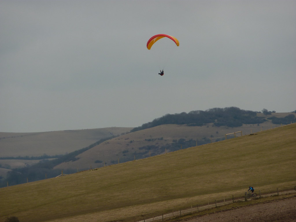 Paraglider and MTBer near Truleigh Hill, shoreham one of the best launches in sussex Flickr CC 2.0 licence image by Bods