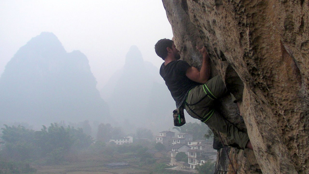 Improve rock climbing strength and fitness in the gym flickr image by Maria Ly