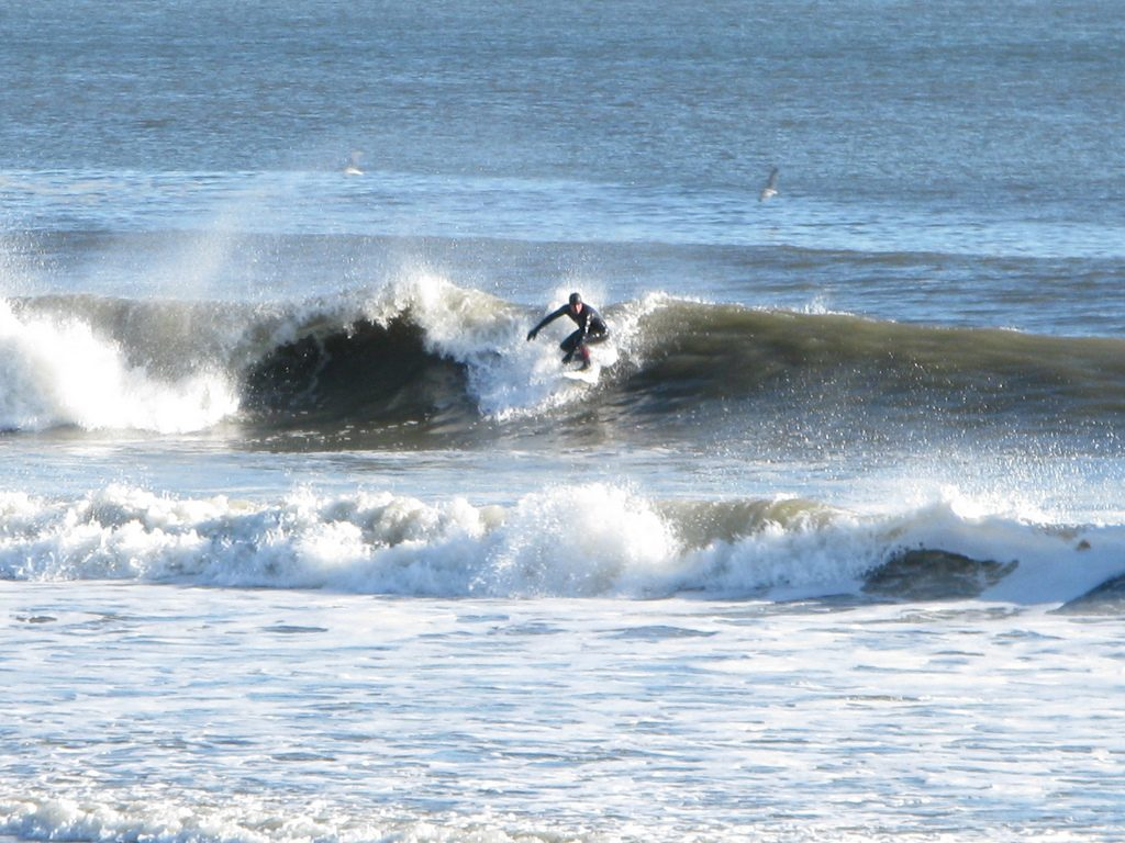 Surfing Rockhampton Beach one of the best New York adventure activities Flickr Image by Dakine Kane