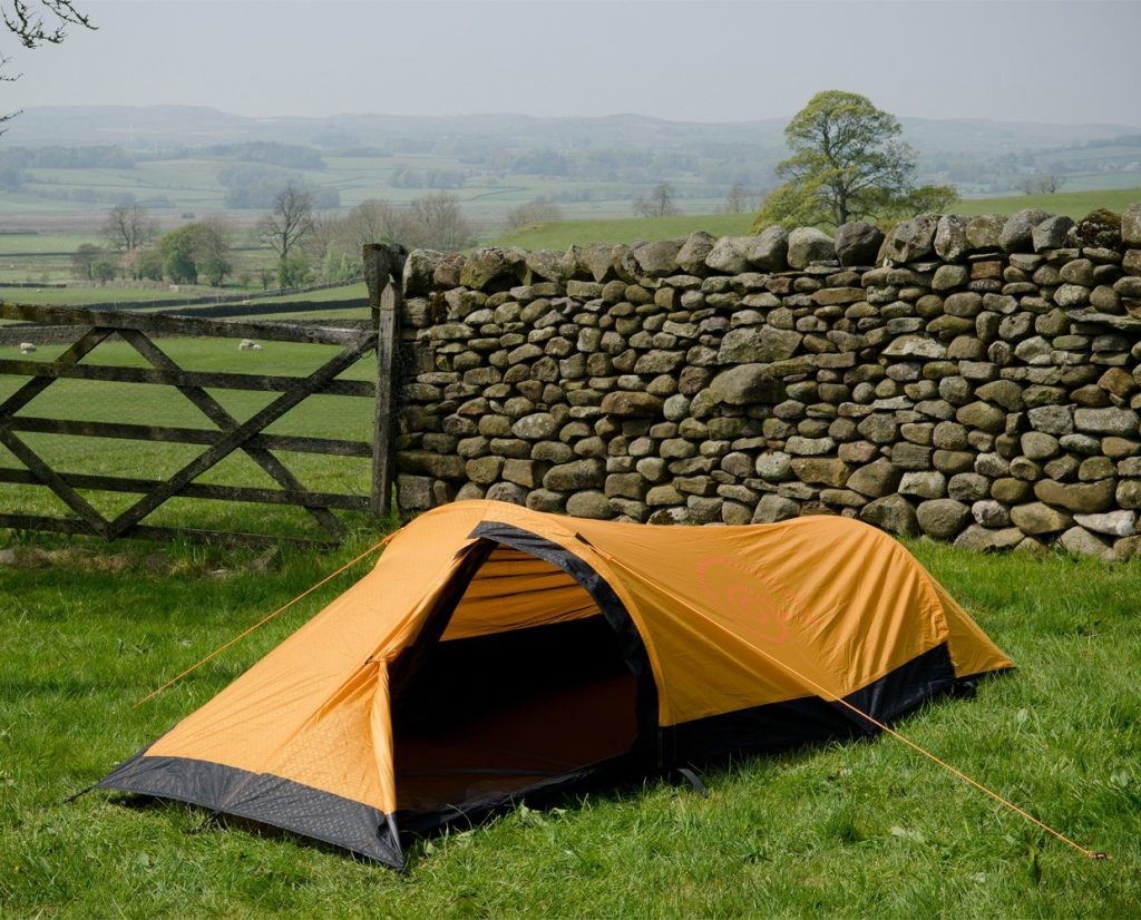 Orange one person tent for hiking by Snugpak