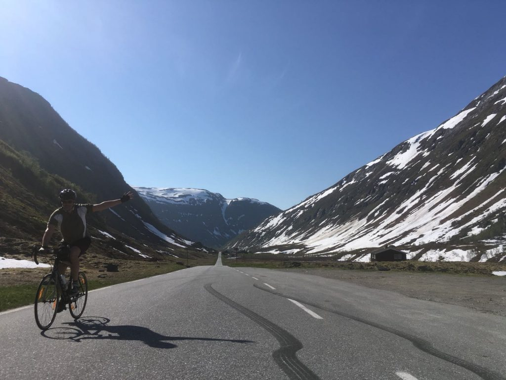 Cyclist on Norway bike tours approaching Vikafjellet