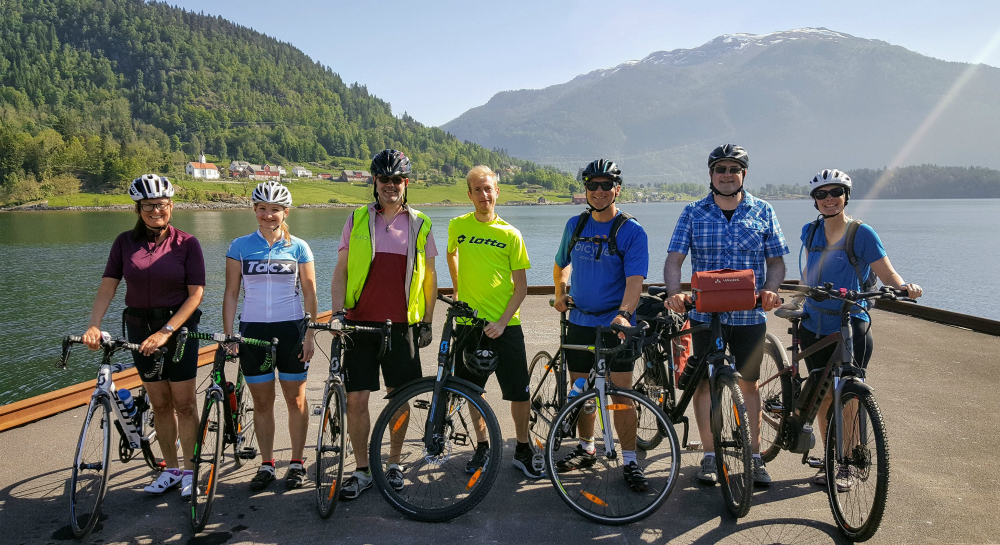 Group of cyclists by Sognefjord with their bikes