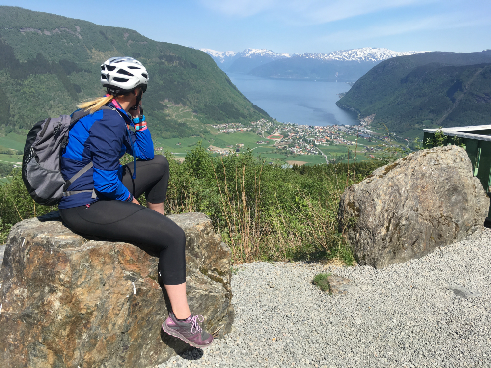 Cyclist looking over Sognefjord on Norway bike holidays