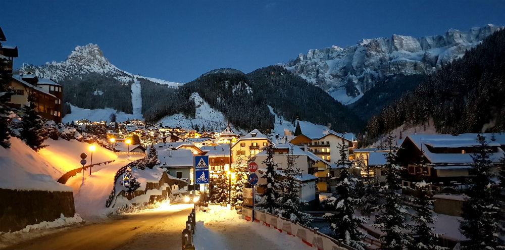Selva Val Gardena at night on Dolomites snowboarding holiday