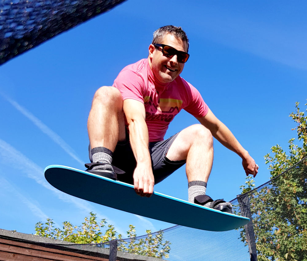 Review of Snowboard Addiction Tramp Board Home snowboard training - Indy grab