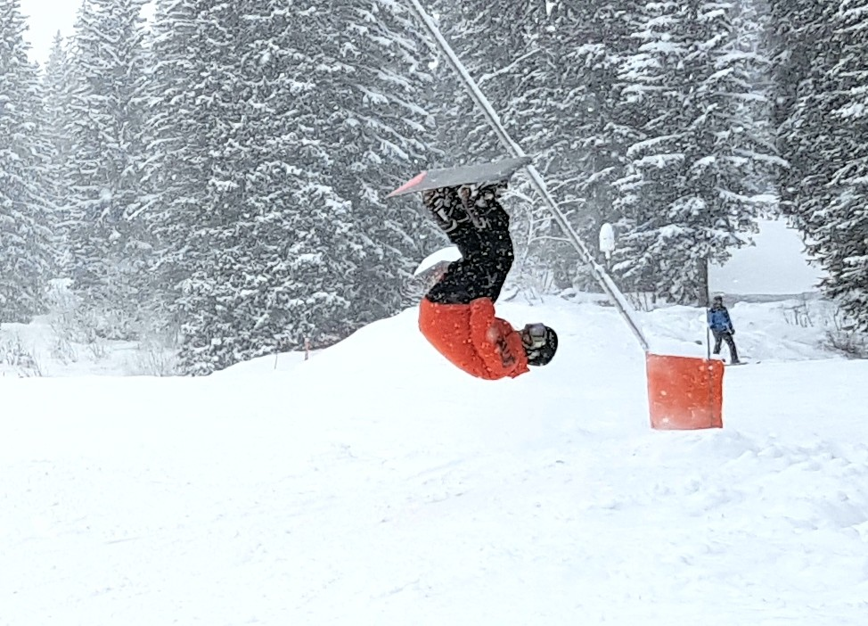 Barry from Real Snowboarding doing a side hit front flip