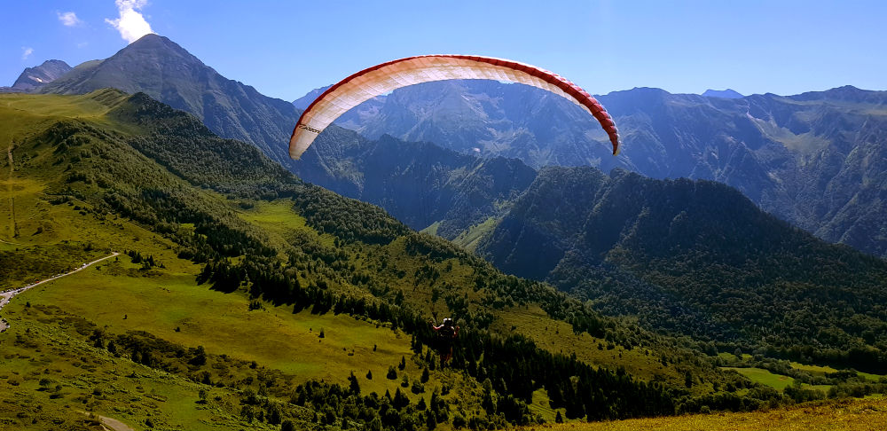 Paragliding in Louron Valley during French Pyrenees Multi activity summer mountain trip