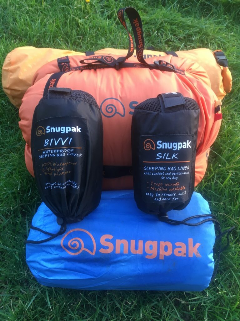 Sleeping bag, roll mat and liners all packed as part of a winter sleeping system