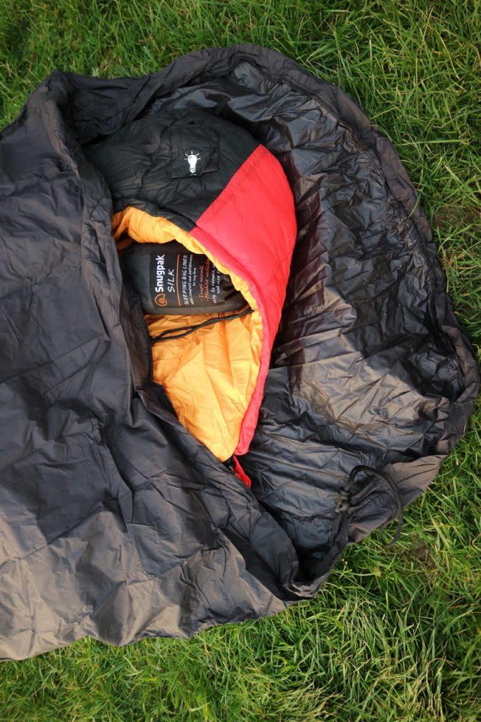 Sleeping bag with bivvi bag over the top