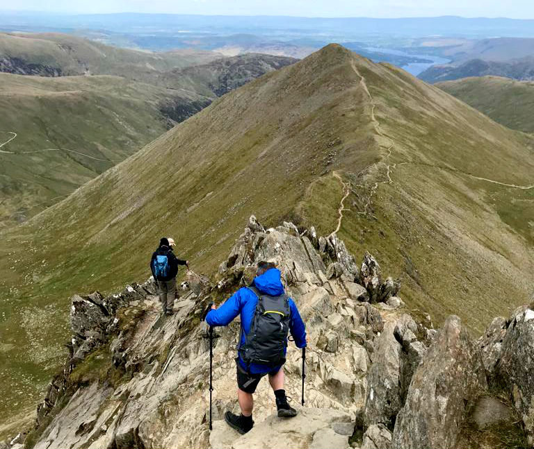 How to reduce knee pain when hiking: 17 tips for trekking with achy knees Hiking down from Helvellyn in the Lake District UK