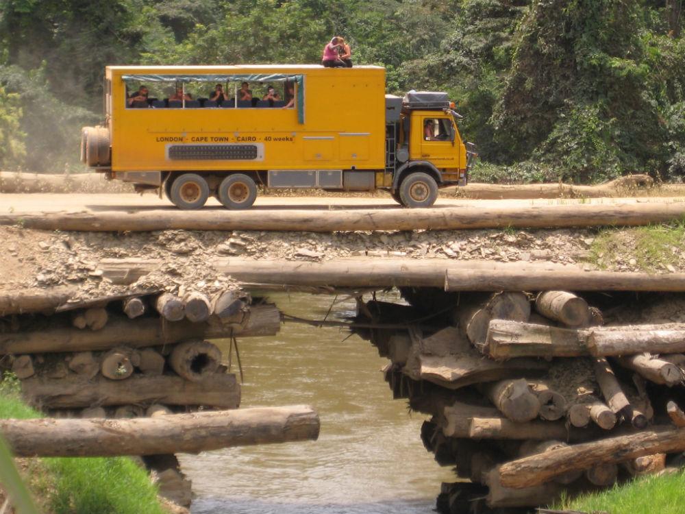 Oasis Overland truck on bridge in Africa