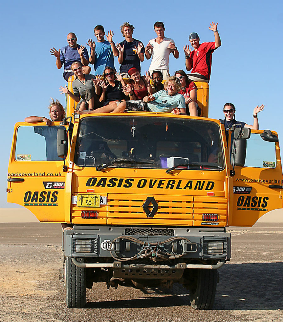 front of Oasis Overland truck