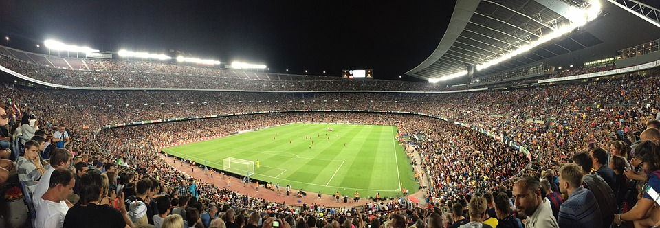 Watching sports vs adventure holidays Is taking part better than observing pixabay royalty free image of Barcelona Camp Nou