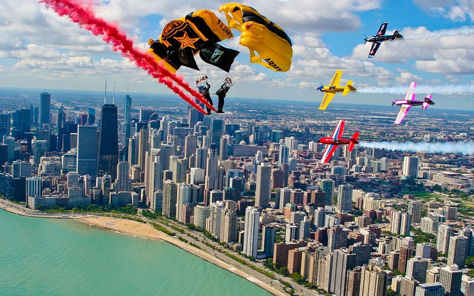 skydiving and airshow over city of Chicago USA watching sports vs adventure holidays Pixabay royalty free image