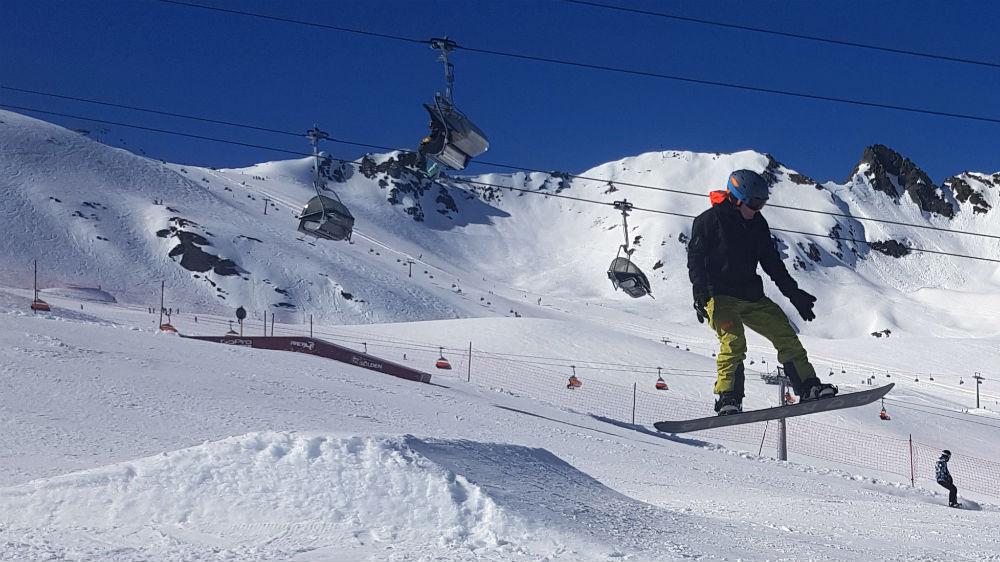 Snowboarding through Area 47 snowpark in Solden