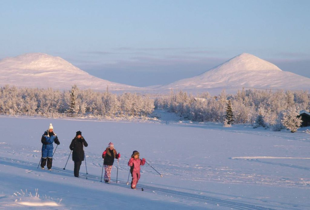 children cross country skiing in Norway image from Undiscovered Alps