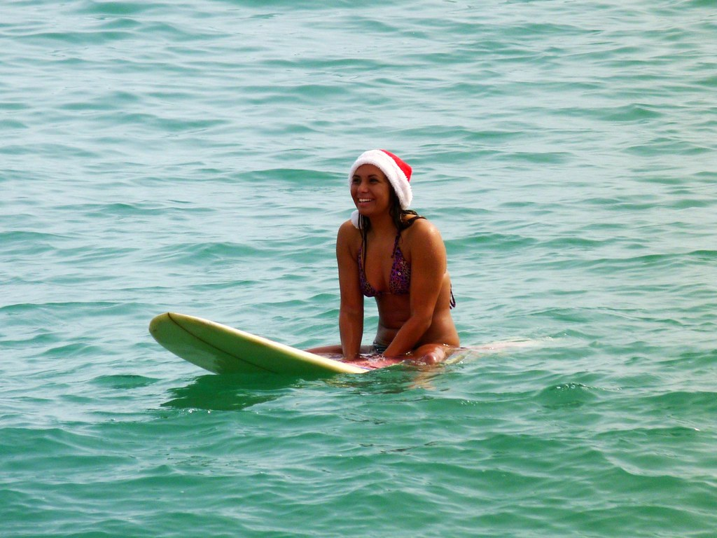 festive activity holidays - surfing in Florida at christmas Flickr CC image by Rusty Clark ~ 100K Photos