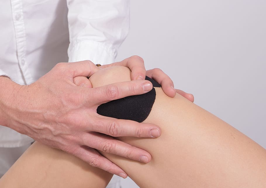 Physio to help avoid knee ache when hiking Wallpaper Flare royalty free image