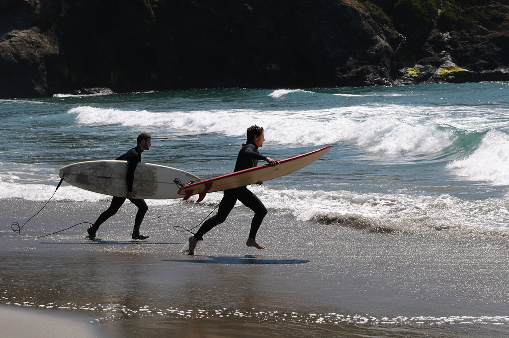 Seattle to San Diego surfing road trip Best west coast surf spots in US Flickr CC image of surfers at Mendocino by Hitchster