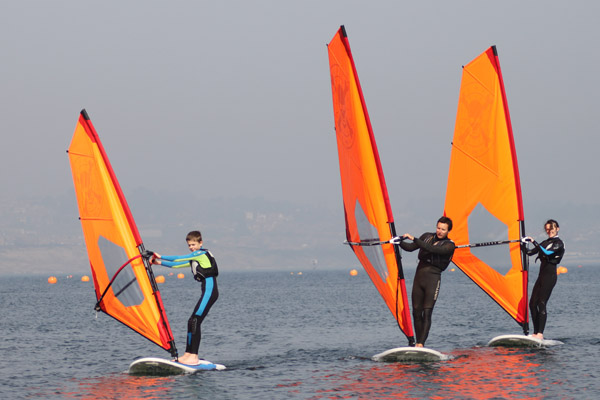 2 hour or 1 day Dorset windsurfing taster session in Portland, UK