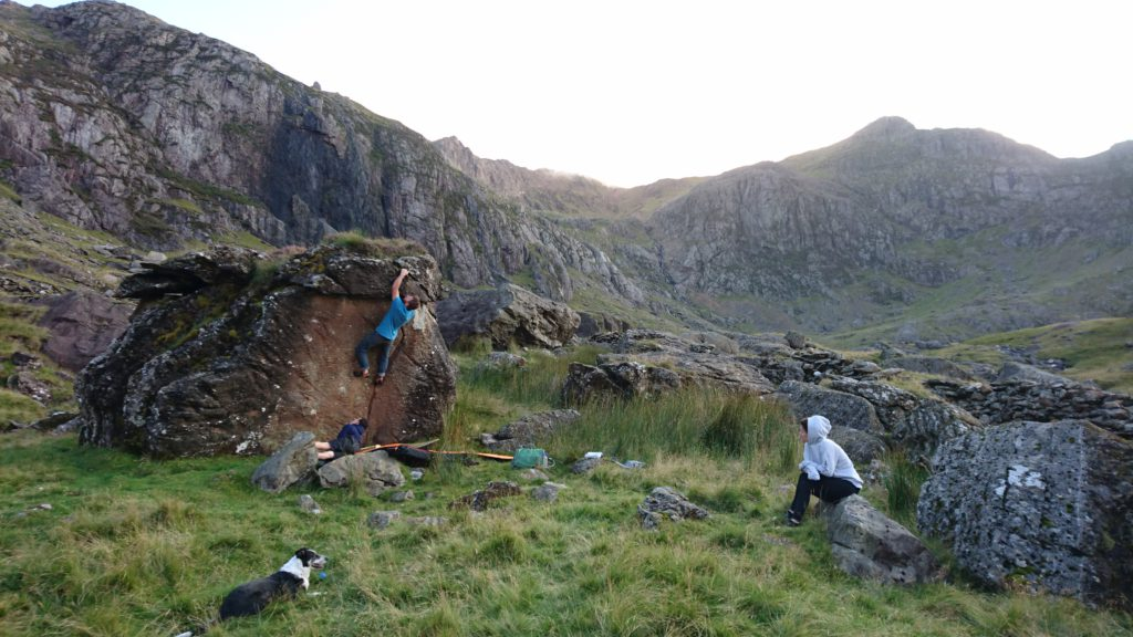 Small group bouldering in a valley in Wales at one of top European boulder destinations