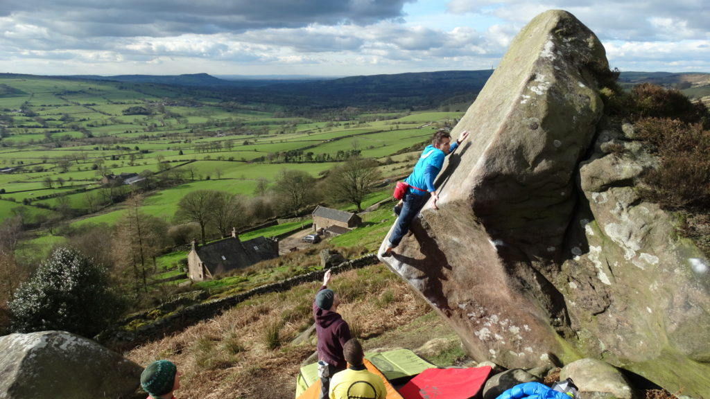 Why try bouldering outdoors? Pablo Sordo on Trust 7a in freezing conditions at the Roaches in the Peak District Photo by Pete Edwards