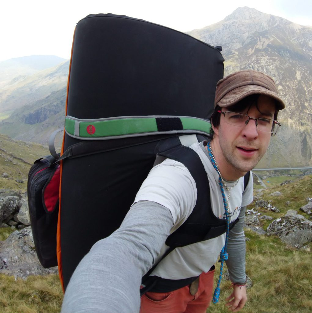 Climber carrying bouldering gear in top European boulder destinations