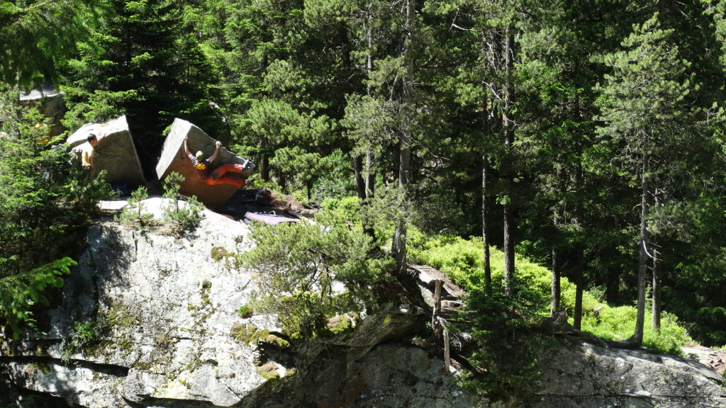 Best bouldering in Europe: Bouldering at the top of a cliff in Switzerland