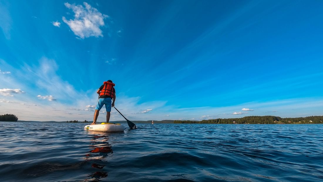 Arctic Paddle Boarding under Midnight Sun: SUP in Lapland
