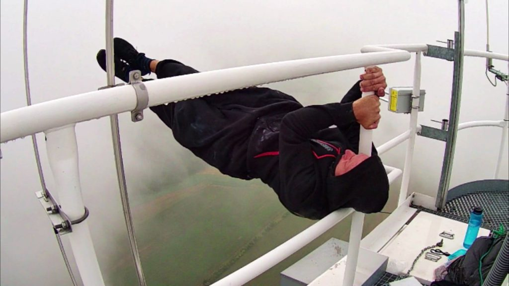 Extreme street workouts and rooftopping Dragon flag 250 meters image copyright of Petr Hulk
