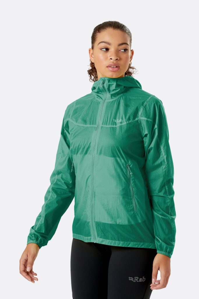 Woman wearing a Rab Vital windproof green windproof jacket with a full zip