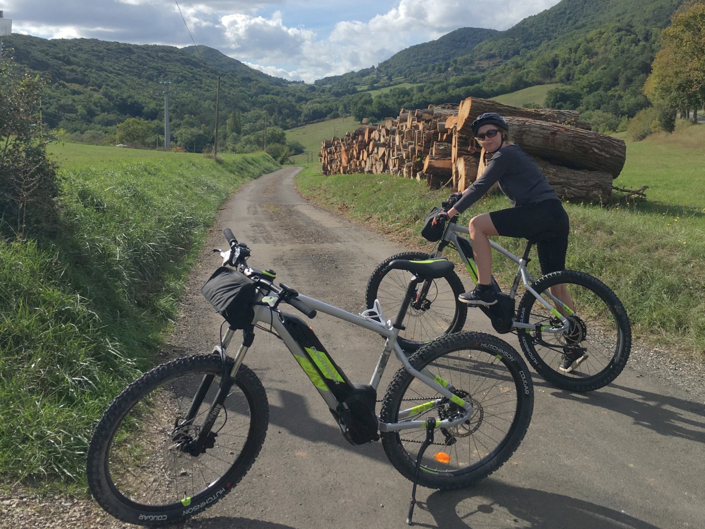 Couple ebiking at the start of a forest valley in Pyrenees foothills